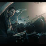 Yanic Bercier behind his Yamaha drum kit in music video As Hope Welcomes Death by Gone in April